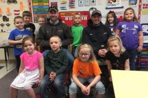 Kids around lineman for Lineman Appreciation Day